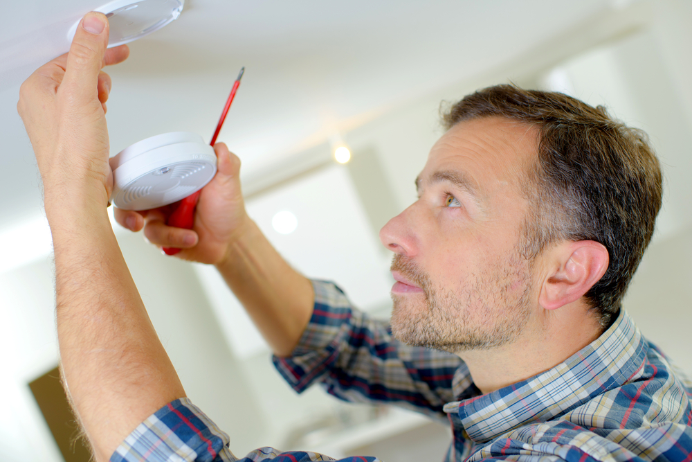 smoke alarm being fitted
